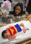Brother-visits-his-sister-in-her-wonderwoman-costume-NICU-Saint-Luke's-Hospital-Kansas-City-March-of-Dime