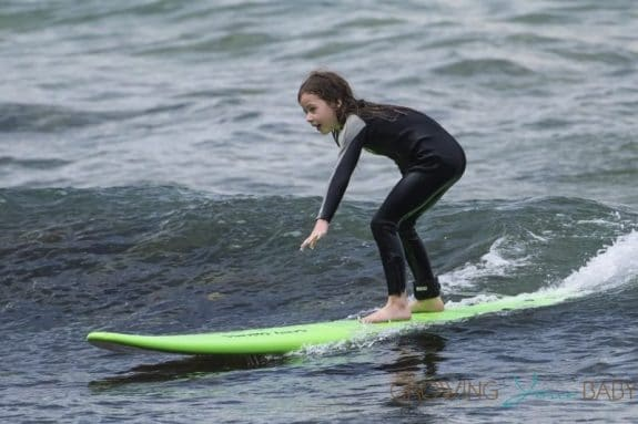 Faith Urban learns how to surf in Australia