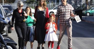 Jessica Alba and husband, Cash Warren, are seen arriving to the Lyft Community Holiday Fiesta Event with their two children, Honor and Haven
