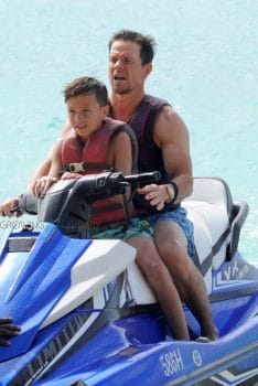 Mark Wahlberg take the jet ski out in Barbados with his son