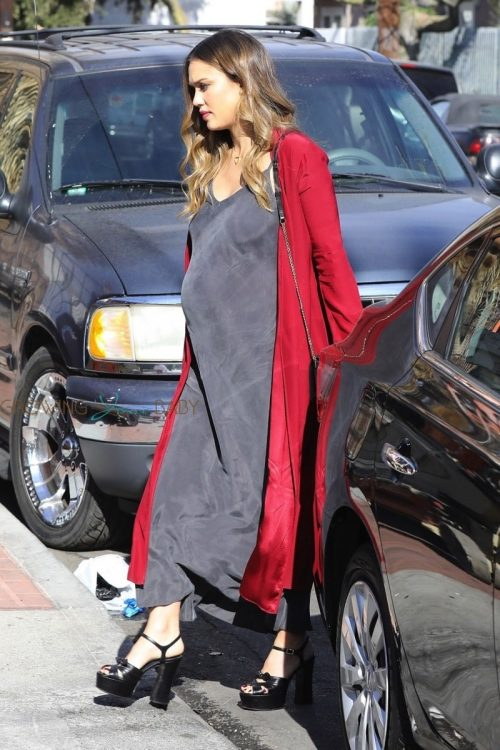 Pregnant Jessica Alba arrives at Lyft event