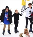 Harper Beckham, Romeo Beckham, and Cruz Beckham go ice skating with their nannies in Central Park New York City