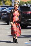 Pregnant Kirsten Dunst shows off her baby bump while out grabbing groceries
