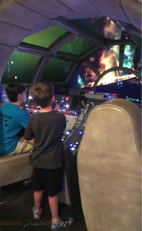 Disney Dream Oceaneer Club - kids flying the Millenium Falcon