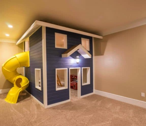 Indoor two story playhouse with slide