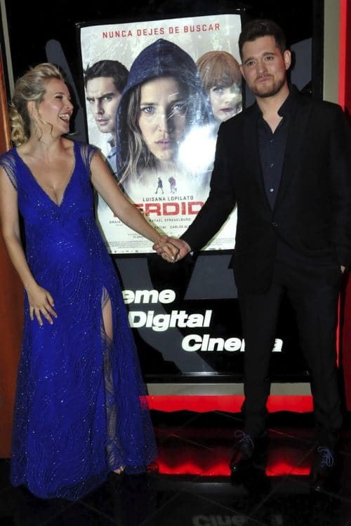"Michael Buble and pregnant wife Luisana Lopilato pose for photos at ""Perdida"" premiere"