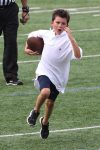 Benjamin Brady running the ball at dad Tom Brady's Best Buddies Charity Event