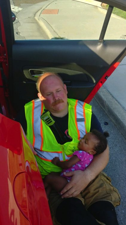Firefighter Hailed As Hero For Cuddling Baby At Accident Scene