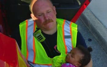 Firefighter Hailed As Hero For Cuddling Baby At Accident Scene f
