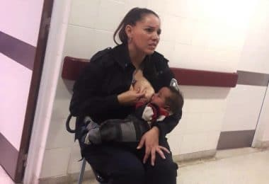 Police Office Breastfeeds Hungry Baby in Hospital f