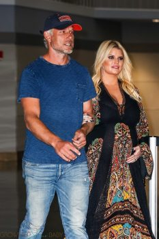 Jessica Simpson lands in NY with husband Eric Johnson after revealing she's pregnant