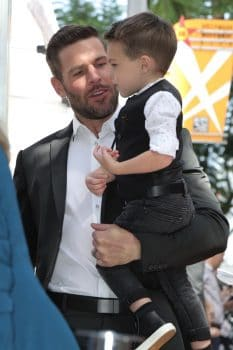 Mike and Isiah Fisher attend Carrie Underwood's Hollywood Walk Of Fame ceremony
