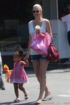 Paige Butcher plays with her daughter outside a Beverly Hills store