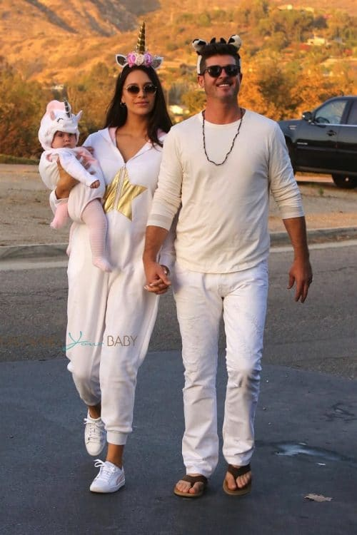 Robin Thicke and April Love Geary take their infant daughter Mia out for Halloween in Malibu.