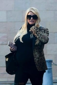 Pregnant Jessica Simpson enjoys a Christmas event with her family.