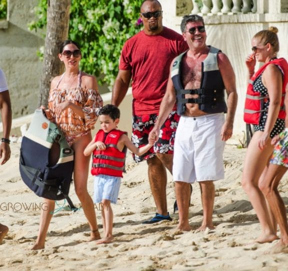Simon Cowell and his partner Lauren Silverman and son Eric Cowell enjoy an afternoon in Barbados