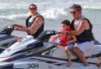 Simon Cowell and his partner Lauren Silverman and son Eric Cowell enjoy an afternoon on jet skis in Barbados