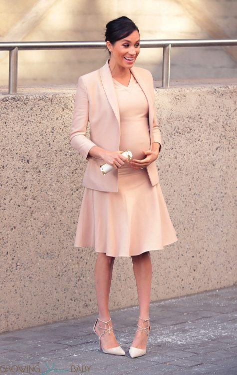 Pregnant Meghan Markle, Duchess of Sussex shows off her baby bump at the National Theatre in London
