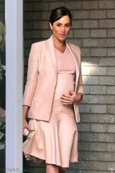 Pregnant Meghan Markle, Duchess of Sussex shows off her growing baby bump at the National Theatre in London
