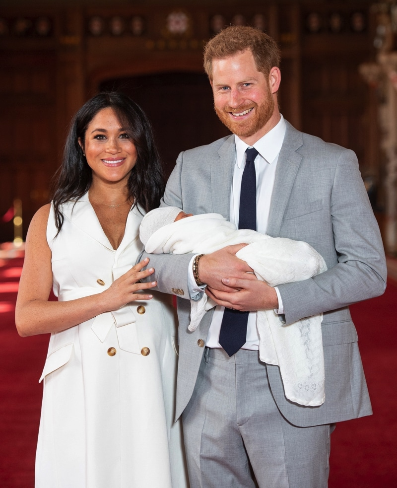 Prince Harry, Duke of Sussex and Meghan, Duchess of Sussex, pose with their newborn son Archie