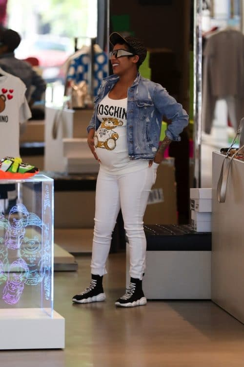 Keyshia Cole shows off her baby bump while shopping at Moschino