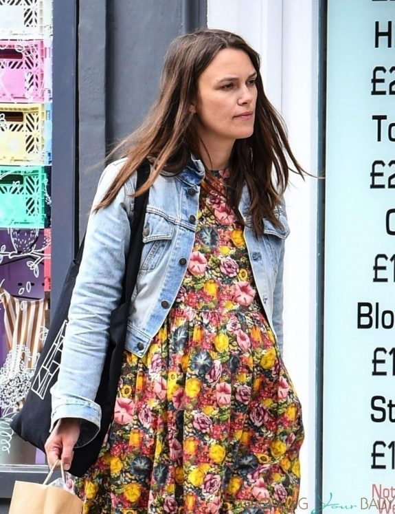 Pregnant Keira Knightley shows off her baby bump while wearing a floral dress out in London
