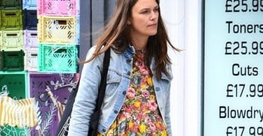 Pregnant Keira Knightley shows off her baby bump while wearing a floral dress out in London 2019