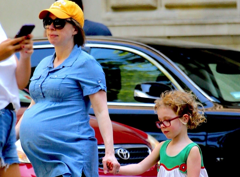 Chelsea Clinton showed off her huge baby bump while grabbing lunch at Shake Shack with her daughter Charlotte on Saturday, July 13th, 2019.