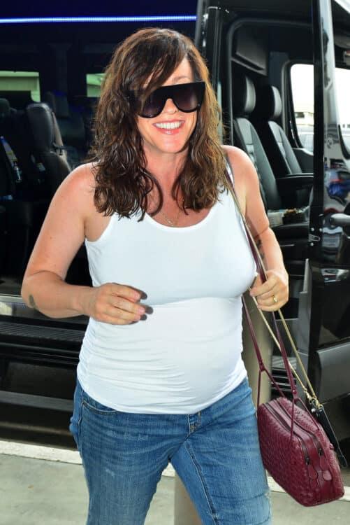 Pregnant Alanis Morissette looks happy at LAX