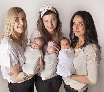 Judit Minda with her triplets and sisters