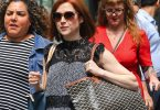 Pregnant Ellie Kemper shows off her growing baby bump in NYC F