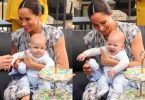 Meghan Markle is seen holding their baby son Archie, during the visit to Archbishop Desmond Tutu f