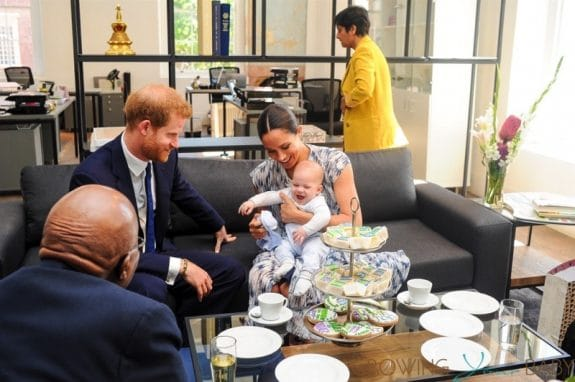 Meghan Markle is seen holding their baby son Archie, during the visit to Archbishop Desmond Tutu - all smiles