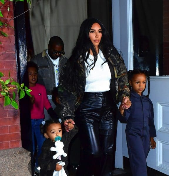 Kim Kardashian and Kanye West head to his album release party with their kids