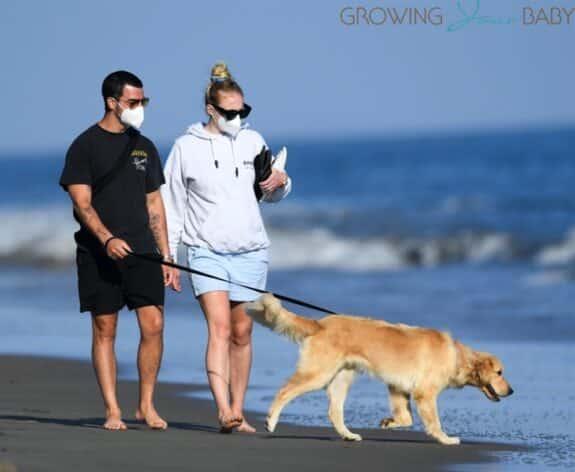 Joe Jonas and pregnant wife Sophie Turner take a romantic walk on the beach in Santa Barbara