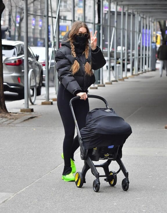 Gigi Hadid steps out in NYC with her baby in a Doona