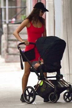 Irina Shayk wears a red mini dress on an outing with her daughter Lea