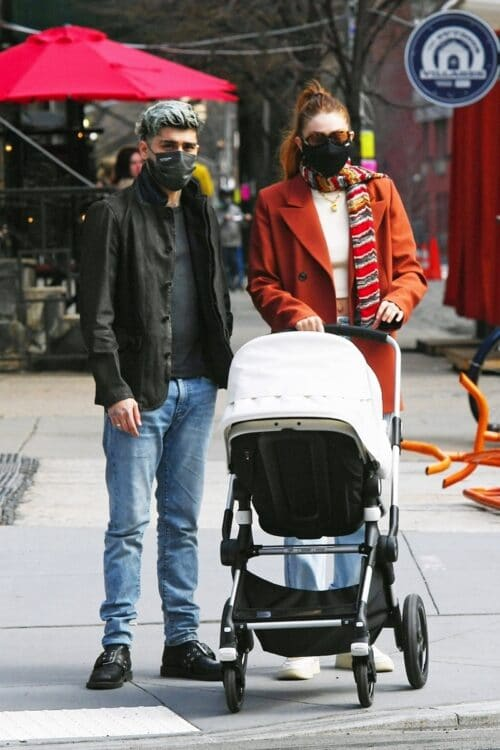 Parents Gigi Hadid and Zayn Malik enjoy an afternoon stroll with their daughter