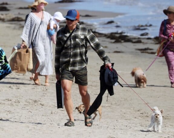 Pop star Katy Perry and husband Orlando Bloom walk with their baby Daisy Dove on the beach in Santa Barbara