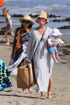 Pop star Katy Perry walks with her baby Daisy Dove on the beach in Santa Barbara