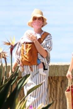 Pop star Katy Perry walks with her baby Daisy Dove on the beach in Santa Barbara