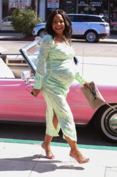 Pregnant Christina Milian poses for pictures at the grand opening of her Beignet Box Cafe in LA