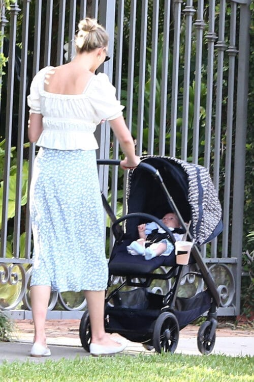 Karlie Kloss goes out for a walk with her newborn baby boy Levi Joseph