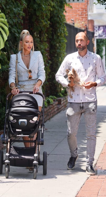 Selling Sunset star Christine Quinn and husband Christian Richard with their son our in LA