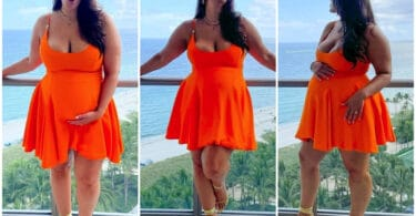 Pregnant Ashley Graham poses on her hotel balcony in Miami