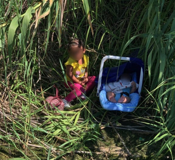 U.S. Border Agents Patrolling The Rio Grande Find Abandoned Toddler And Baby