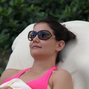 Katie Holmes Relaxes Poolside With Suri