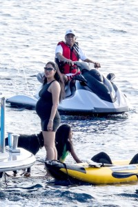 A pregnant Kimora Lee Simmons & Russell Simmons vacation in St