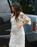 A pregnant Kourtney Kardashian visit her DASH store with sister Kim in Hampton