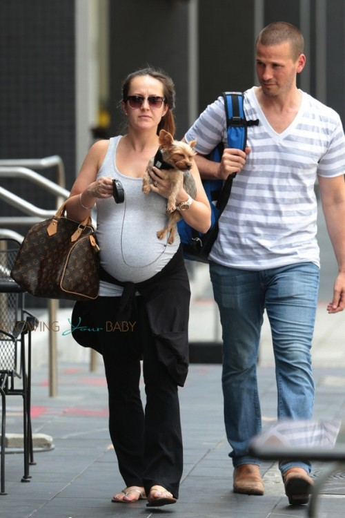 A very pregnant Ashley Hebert with husband J.P Rosenbaum